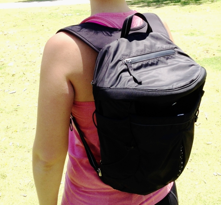 Run All Day Backpack: fits sneakers, has pockets for everything and minimal bounce.