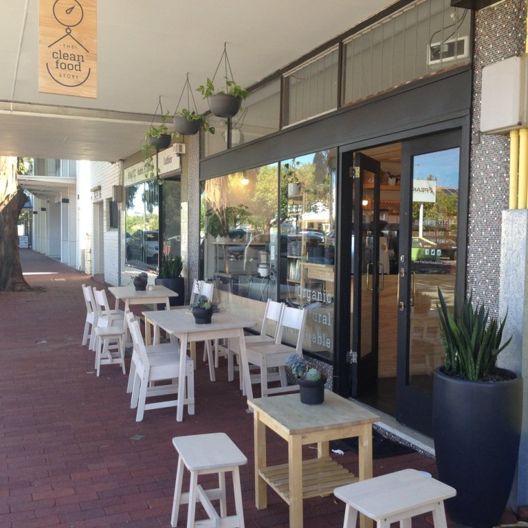 The Clean Food Store: outdoor dining on a quiet street.