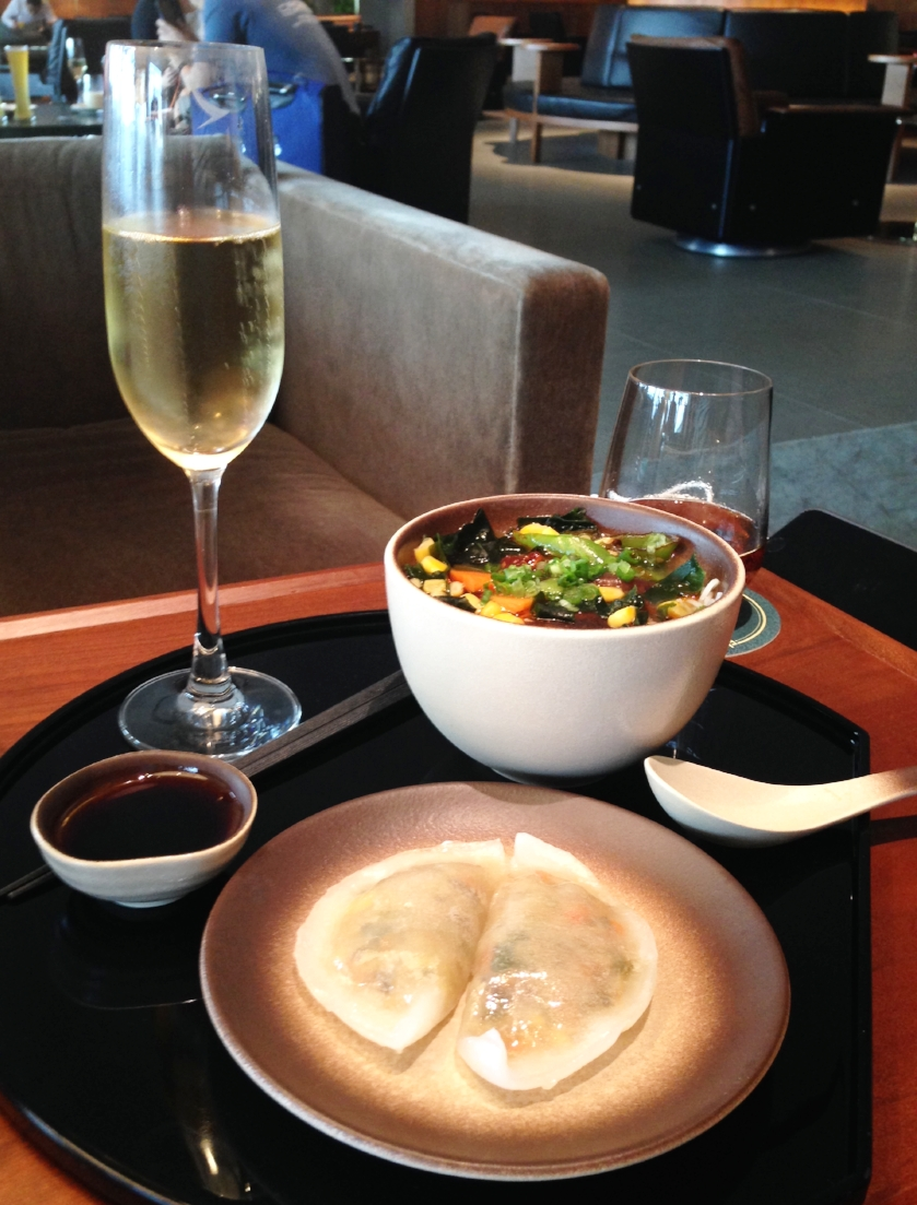 My breakfast!Noodles and dumplings from the Noodle Bar, with Moët.