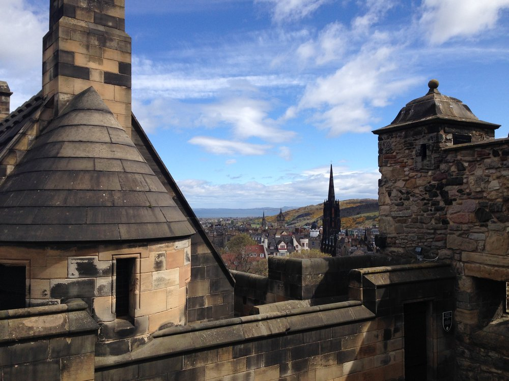 Edinburgh Castle: sweeping views of old buildings, all the way to the ocean.