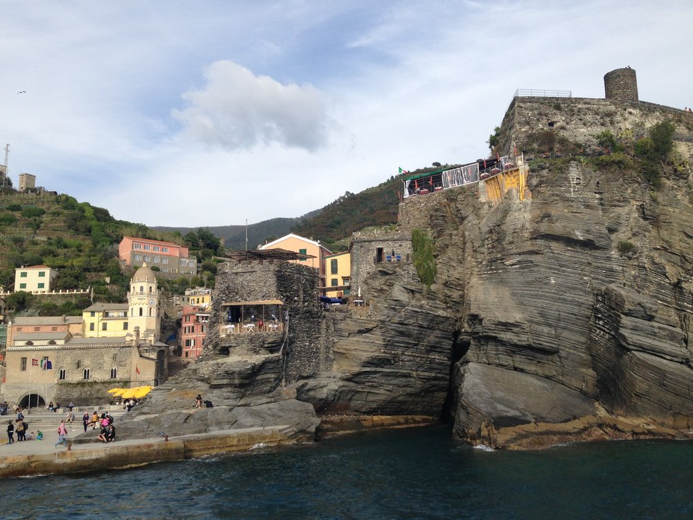 Vernazza: viewed from the ferry. We had lunch at the cafe with the green roof!