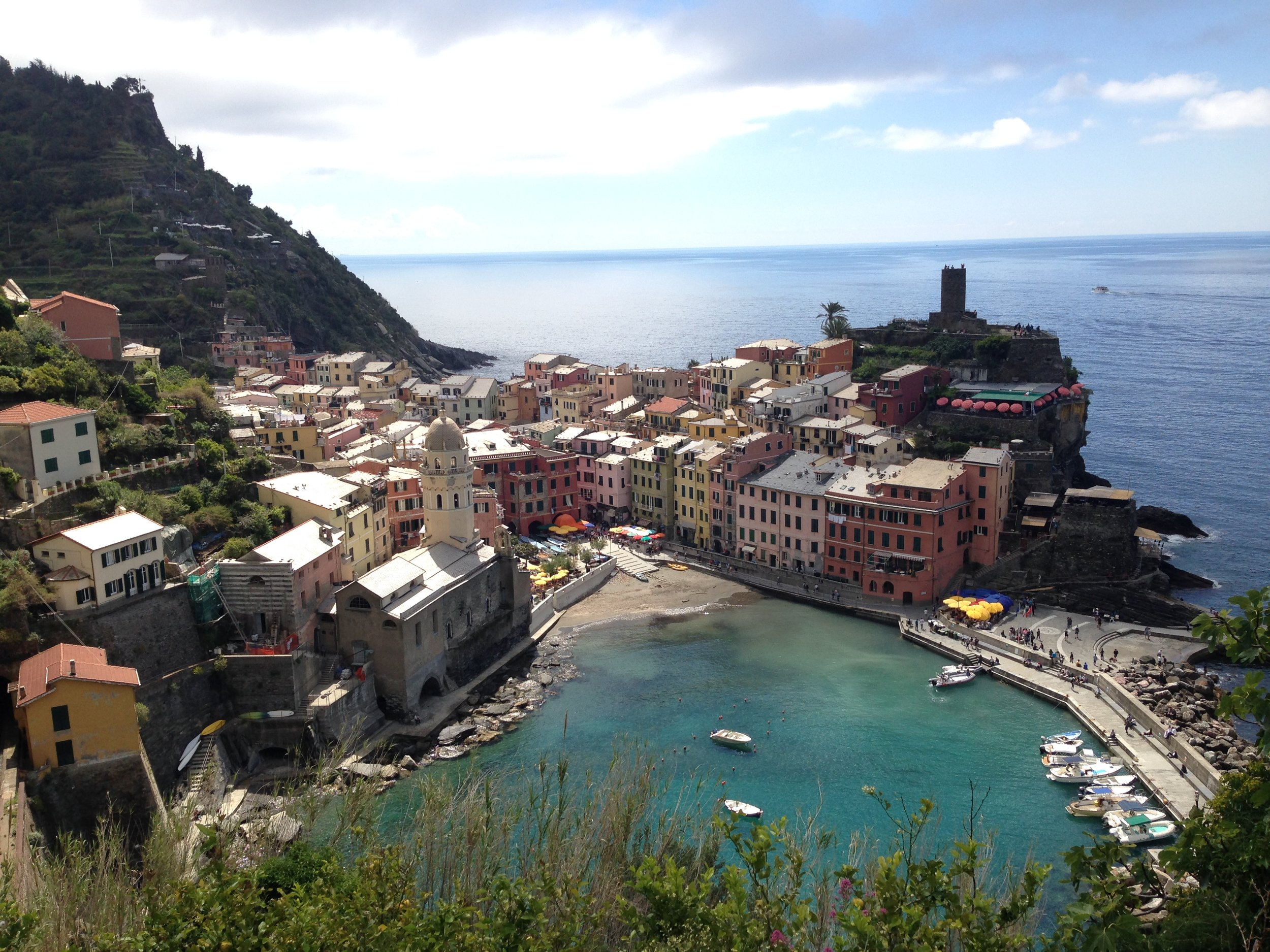 Vernazza: the village has an iconic castle (top right) and pier.