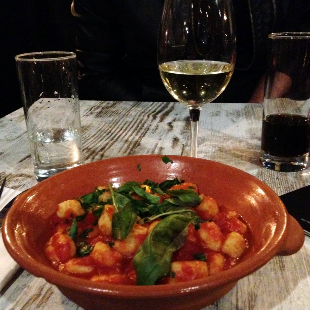 Pappagallo: my dairy-free gnocchi ($19) with fresh basil, but I was jealous of my colleagues' pizzas.