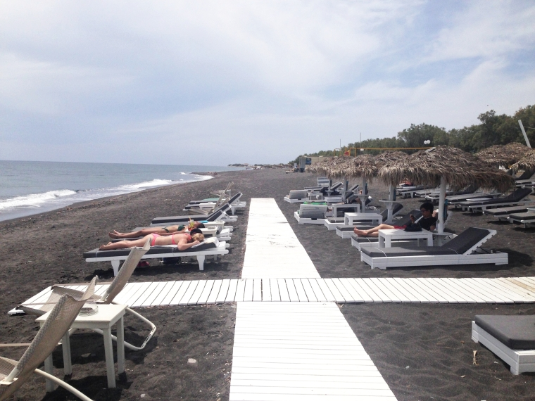 Perivolos Beach: more resort style, with plenty of dining and bars opposite