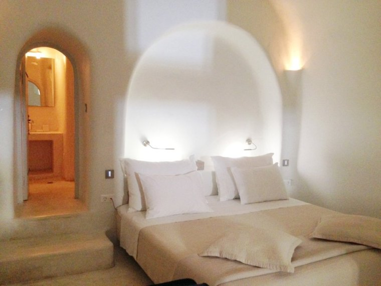 Kapari Natural Resort: the bedroom and bathroom in our enormous cavern-like villa