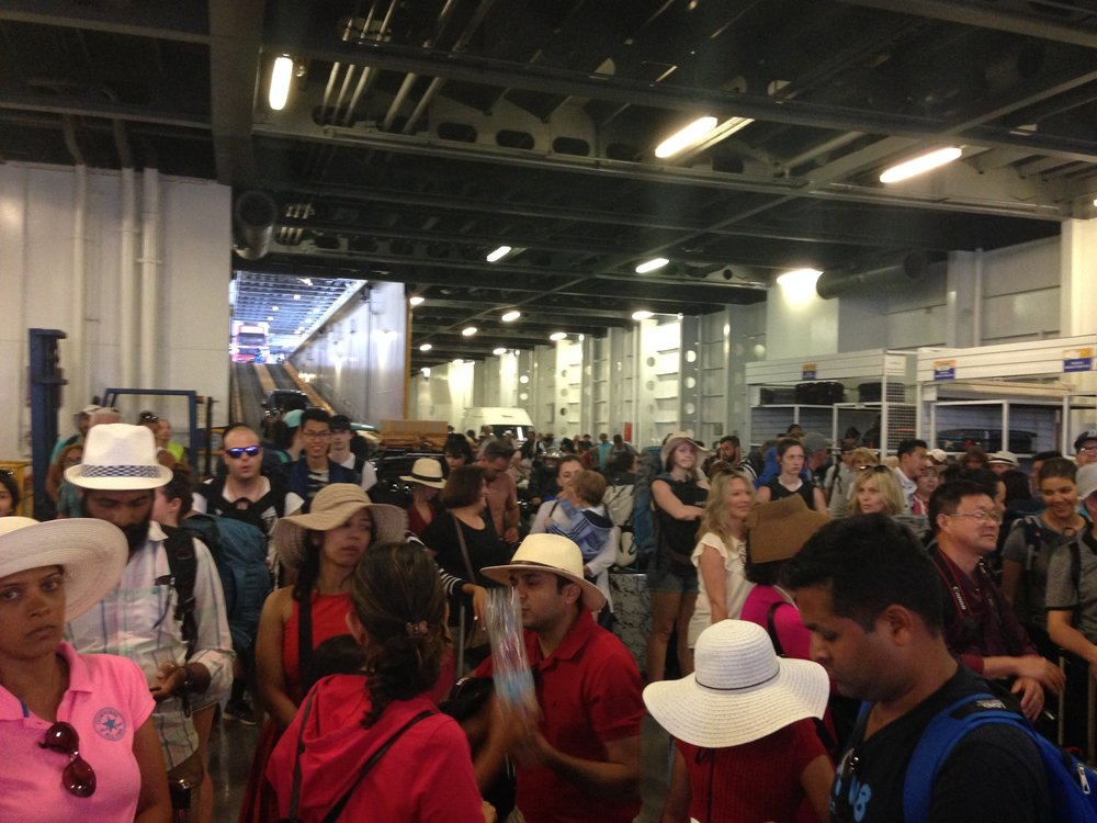Disembarking: get your luggage early and prepare for the mass exodus